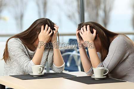 two desperate sad girls in a