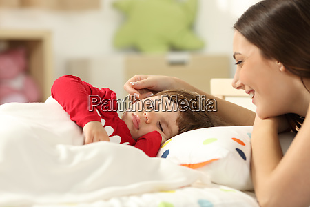 affectionate mother looking at her toddler