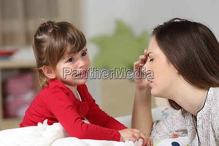 fed up woman and toddler crying