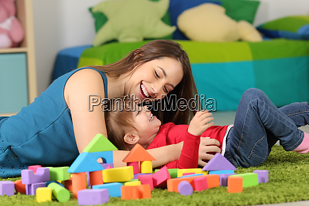 mother or nanny playing with a