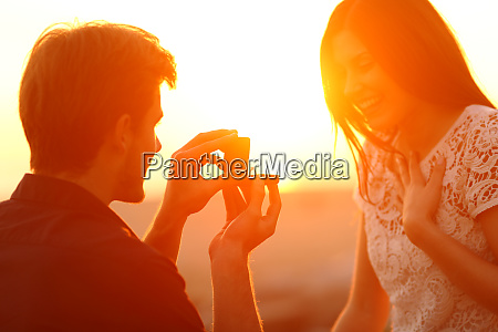 successful marriage proposal at sunset