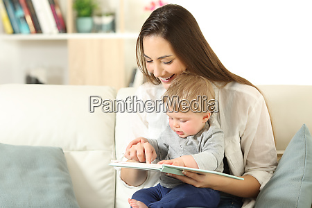 baby and mother reading a book