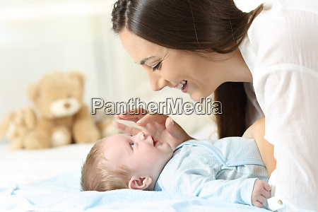 profile of a mother playing with