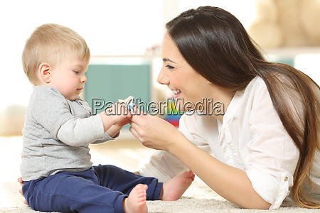 proud mother giving a pacifier to