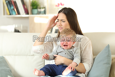 mother suffering and baby crying desperately