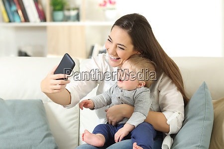 mother taking a selfie with her