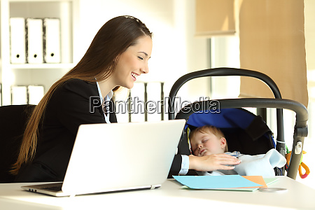 mother working and taking care of