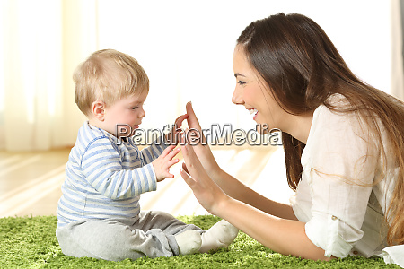 mother playing with her baby on