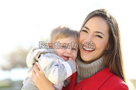 happy mother holding her son baby