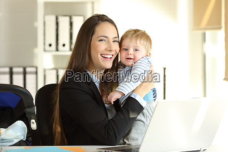 happy working mother posing with her