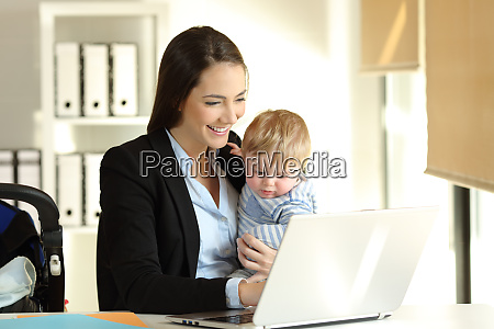 mom working with her baby son