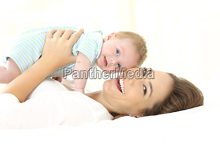 mother and baby looking at camera