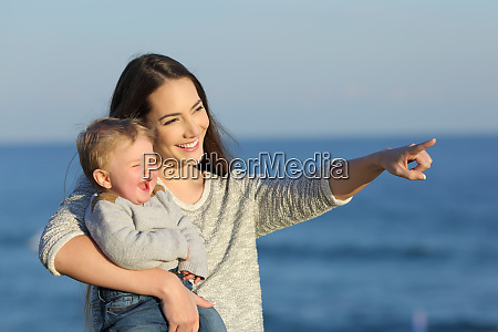 mother and kid laughing and looking