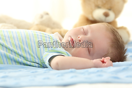 single baby sleeping on a bed