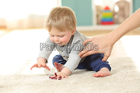 mother hand preventing the baby from