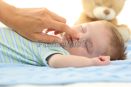 mother hand touching nose of a