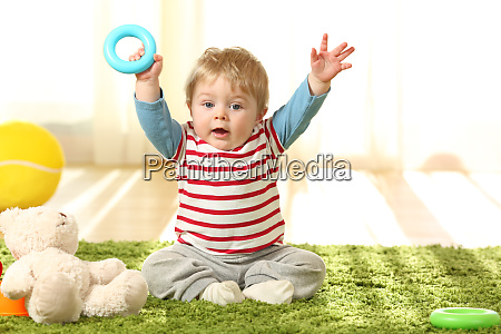 happy baby raising arms with a