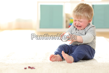 baby crying in danger after eating