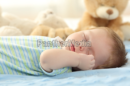 cute baby sleeping on a bed