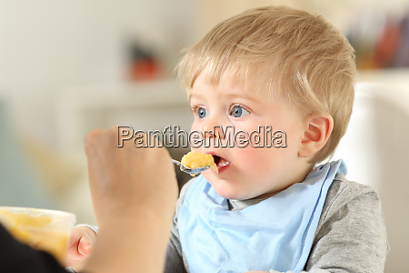 mother, feeding, a, baby - 26549924