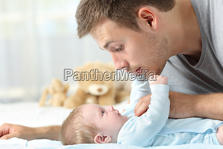 baby and father playing together