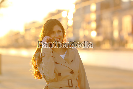 happy lady talking on phone at