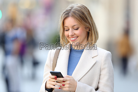 elegant woman using a smart phone