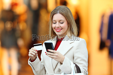 happy woman buying online with credit