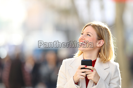 happy woman looking at side holding