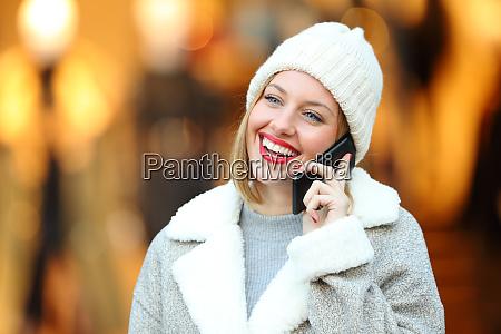 happy woman talking on phone in