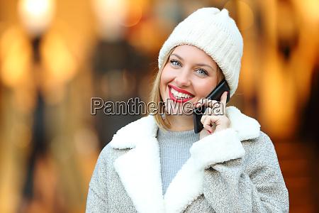happy woman talking on phone looking