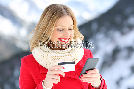 woman paying with credit card and