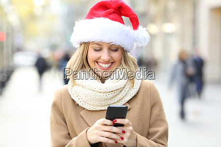woman reading phone text on christmas