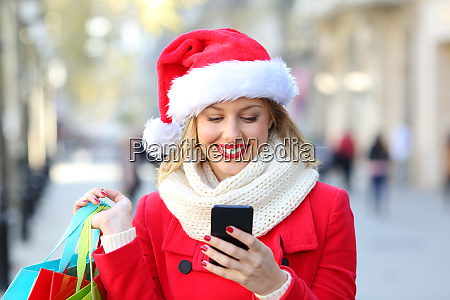 shopper checking phone content on christmas