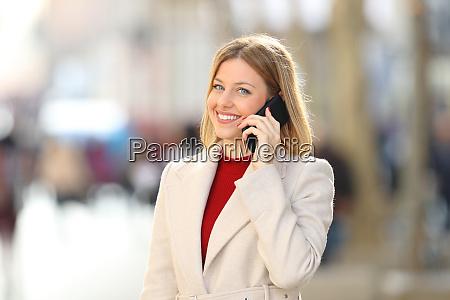 woman having a phone conversation looking