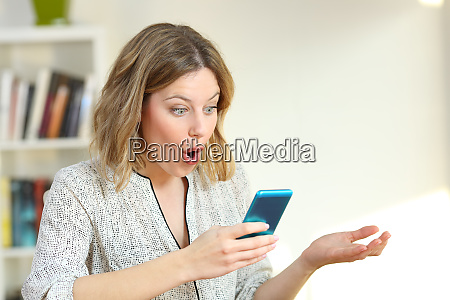 surprised girl watching online content in