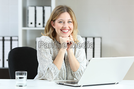 satisfied employee looking at camera at