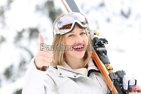 happy skier with thumbs up in