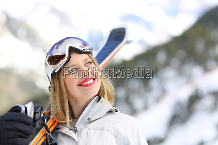 satisfied skier looking at side in