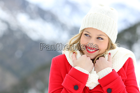 candid woman keeping warm in winter