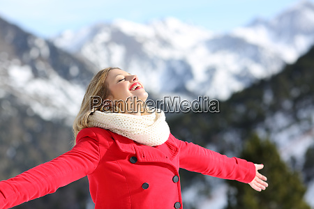 carefree woman breathing fresh air in