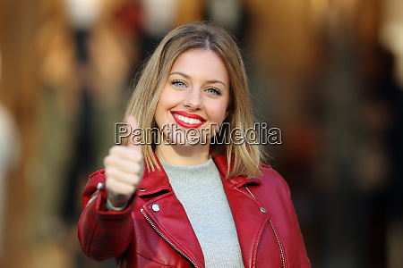 fashion girl with thumb up looking
