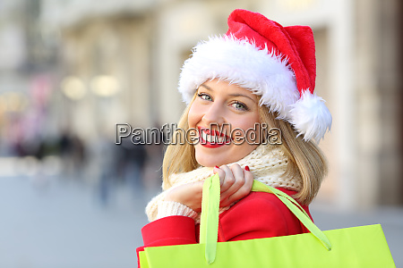 happy girl shopping in christmas looking