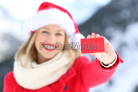 woman showing credit card in christmas