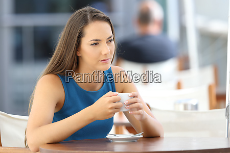 serious woman thinking in a coffee