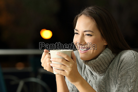 happy girl drinking coffe in the