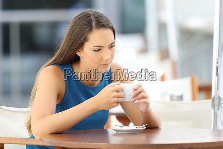 longing pensive woman in a coffee
