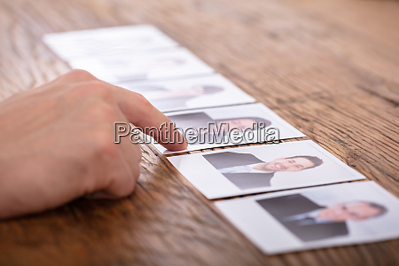 businessperson selecting candidates photograph