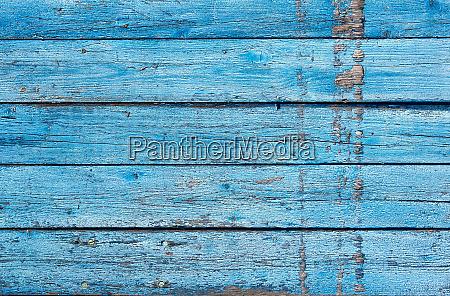 very old wooden background with blue