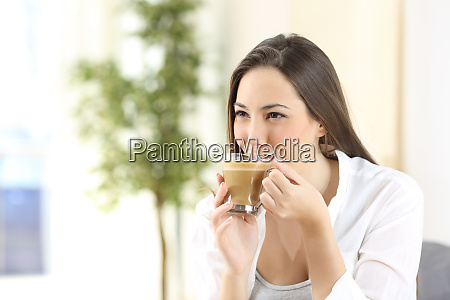 woman drinking a delicious coffee with